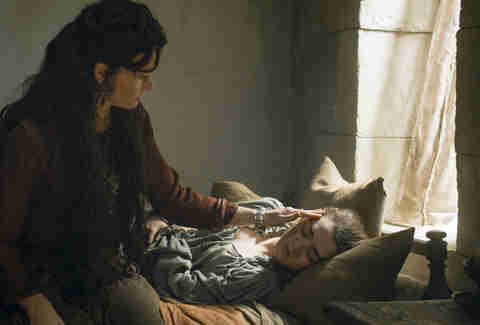 Essie Davis as Lady Crane nursing Maisie Williams as Arya Stark back to health