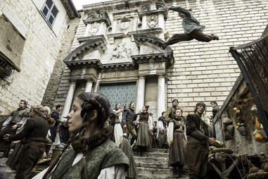 Maisie Williams as Arya Stark in a chase scene across Braavos