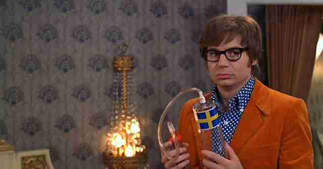Austin Powers holding a penis enlarger