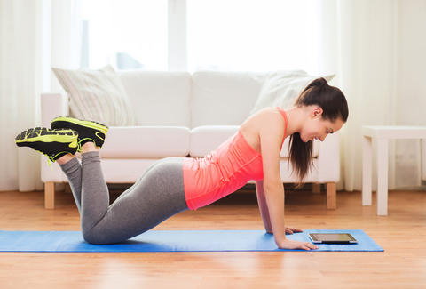 woman working out with smart tablet