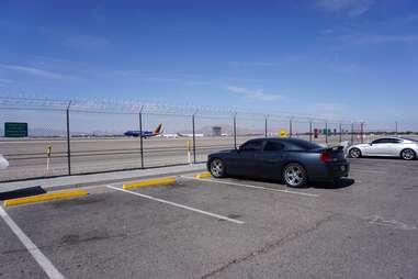 Car watching plane traffic