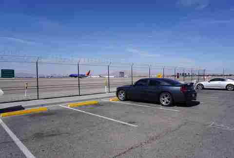 Car watching plane traffic