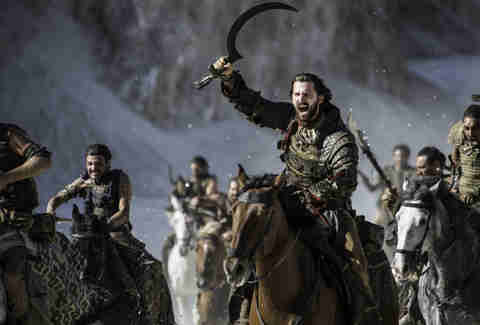 Michiel Huisman as Daario Naharis riding with the Dothraki
