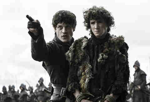 Iwan Rheon as Ramsay Bolton and Art Parkinson as Rickon Stark