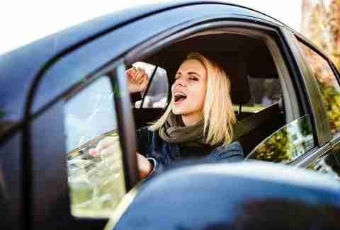 woman singing in car