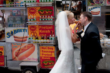 Bride and Groom eat a hot dog