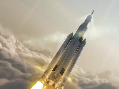 NASA's SLS and orion launching through clouds