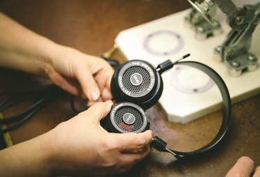 woman making grado headphones