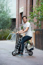 man riding Urb-E electric scooter