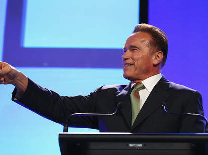Arnold Schwarzenegger giving speech in a suit