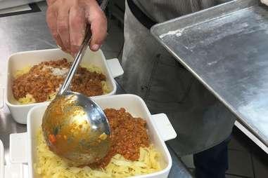 plating fresh pasta bolognese