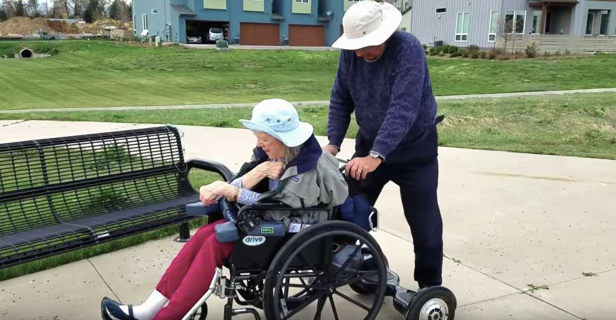 Old Man Using Hoverboard To Push Wife S Wheelchair Is Real