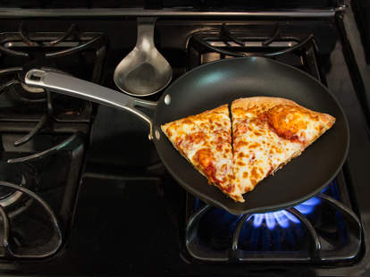 Leftover pizza on the stove