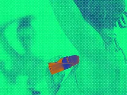 woman applying deodorant mirror
