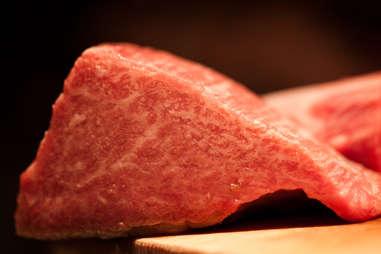 Kobe beef on a wood plate