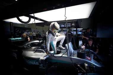 Lewis Hamilton climbs out of his car