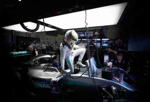 Lewis Hamilton climbs out of his car