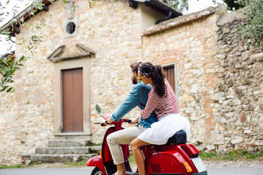 young people riding moped in Florence