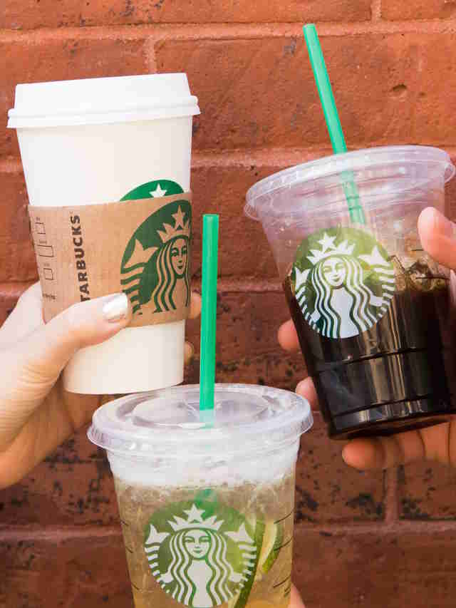 Starbucks drinks held at different angles