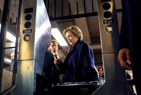 Hillary Clinton trying to take the subway