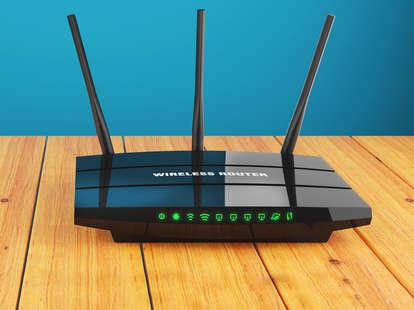 black wireless router on wooden floor