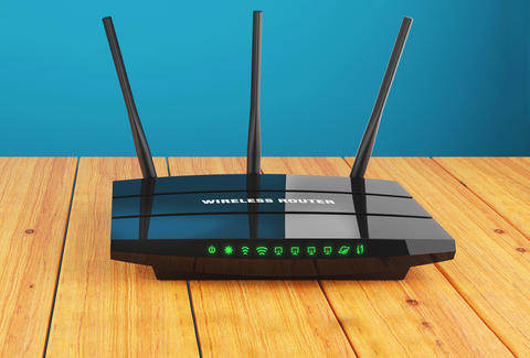 black wireless router on wooden floor