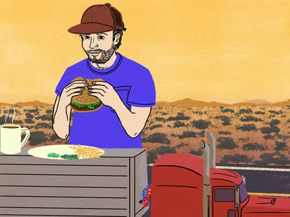 Truckers eating food a giant truck