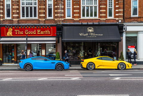 A Blue Aston Martin and Yellow Lexus