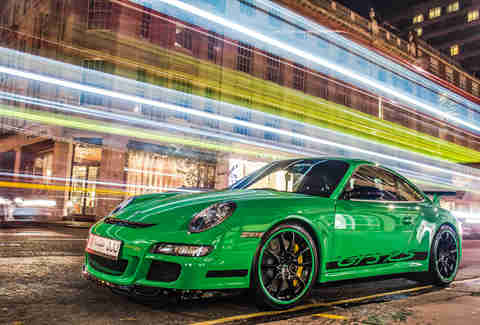Green Porsche 911 at night