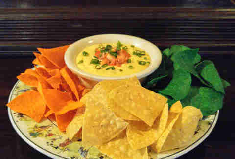 Harp and green onion queso Trinity Hall Irish Pub