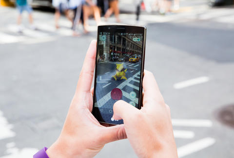 Pokemon Go player on the street
