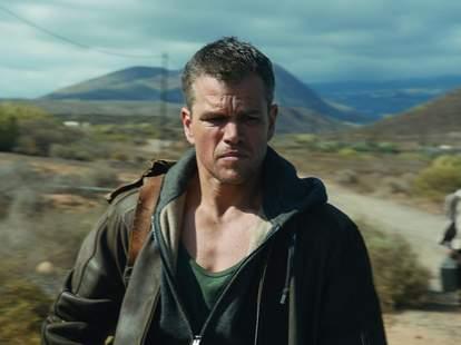 Jason Bourne with bag over his shoulder
