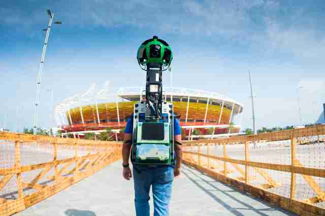 man with google street view camera strapped to back