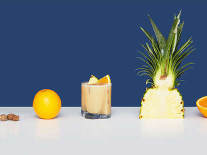 painkiller pineapple drink sweet rum orange coconut alcohol recipe cocktail