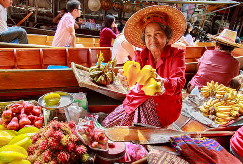 Woman selling fruit in Thailand market