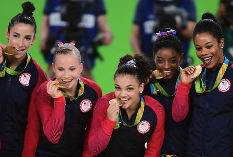 USA women's gymnastics team with gold medals at Rio Olympics 2016