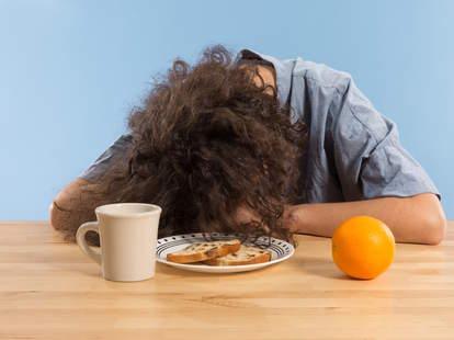 Woman asleep on the table