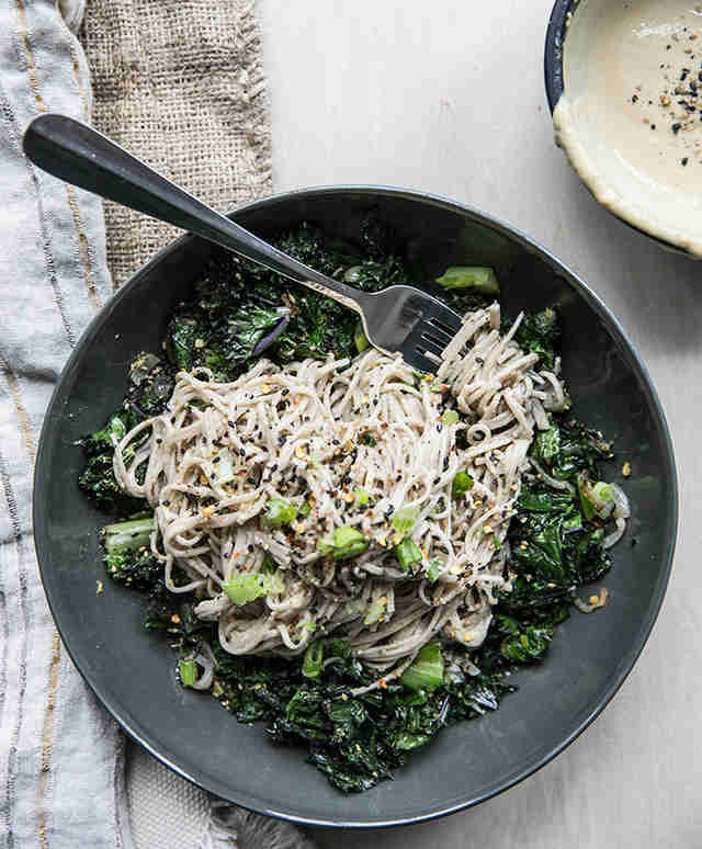 Soba noodles and ginger tahini with crispy kale, shallots, and romaine