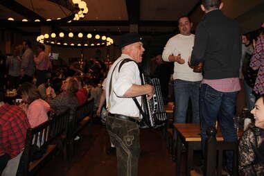 band plays among crowd at beer hall