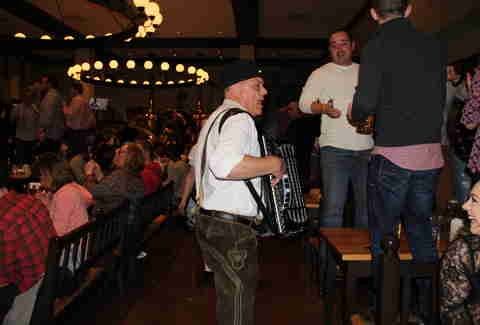 band plays among crowd at beer hall