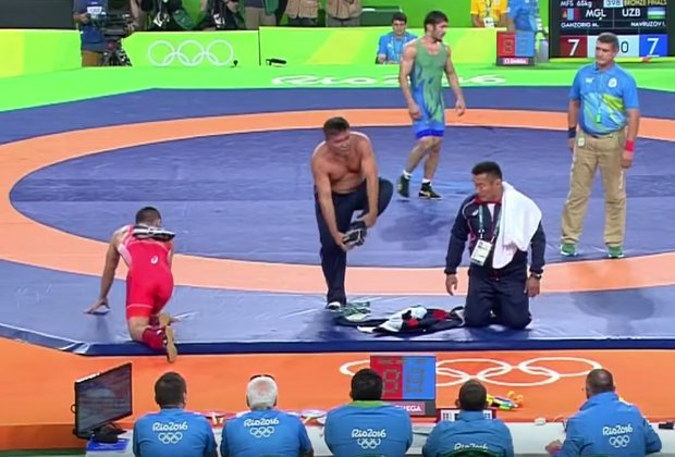 Olympic Wrestling Coach Angrily Strips Down in Front of Judges