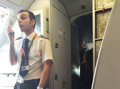 Flight steward addresses passengers on easyJet plane