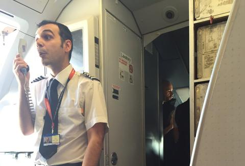 Flight steward addresses passengers on easyJet plane