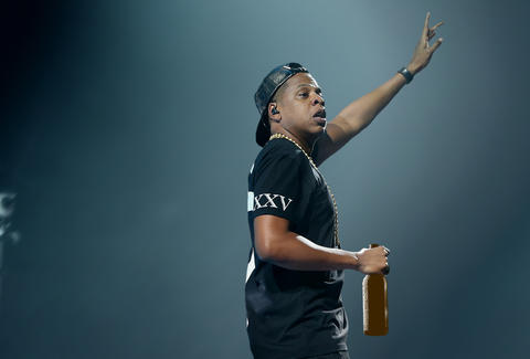 Jay-Z drinking a beer