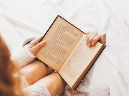 woman reading a book erotica