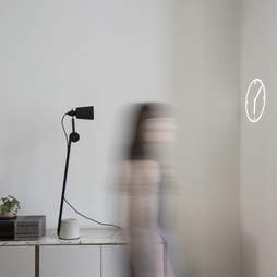 beam smart lightbulb projecting on wall with clock