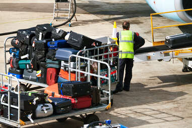 loading baggage on a plane