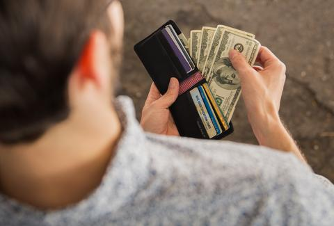 man pulling cash out of his wallet