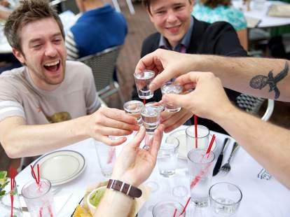 friends taking shot cheers