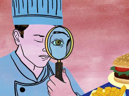 chef looking at hamburger